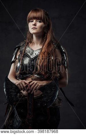 Beautiful But Dangerous Warlike Woman Viking With Long Brown Hairs In Dark Armour Holding Huge Axe I