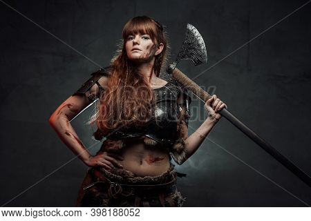 Barbaric And Brown Haired Woman Viking Wielding Two Handed Axe And Dressed In Dark Armour Poses In D