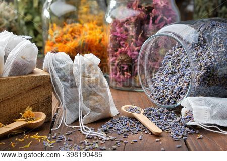 Filter Tea Bags Filled With Medicinal Herbs. Glass Jar Of Dry Lavender Flowers For Making Herbal Tea