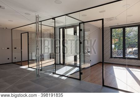 Entrance Of A Building With Modern Offices, Walls Of Glass, Transparent Ambient.