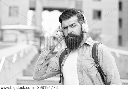 Live Life Loud With Headphones. Hipster Wear Headphones Outdoors. Bearded Man Listen To Music In Hea