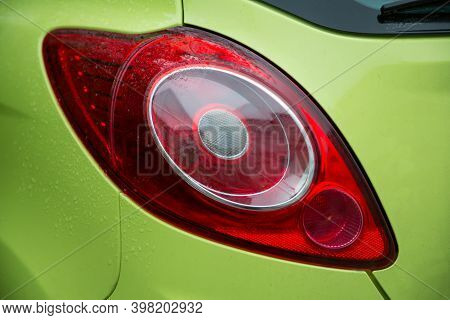 Close-up View Of Green Cars Stylish Taillight