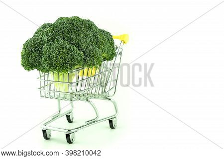 Broccoli Cabbage On A White Background With Space For Text. Metal Shopping Trolley And Fresh Broccol