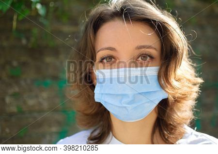 Coronavirus Covid-19 Outbreak. Young Woman Wearing Surgical Mask On The Face For Protection From Vir