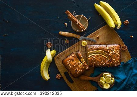 Freshly Baked Banana Bread, Sliced On A Cutting Board, With Banana, Cinnamon And Nuts. Bake Shop, Ho
