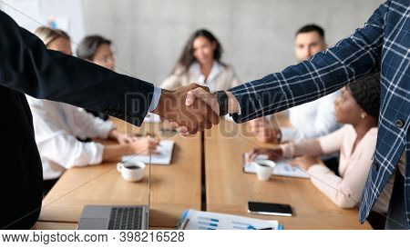Business Partnership. Closeup Of Handshake At Meeting. Two Businessmen Shaking Hands In Deal Agreeme