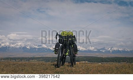 The Mixed Terrain Cycle Touring Bike With Bikepacking. The Trip On Multitrack Bike, Outdoor Road In
