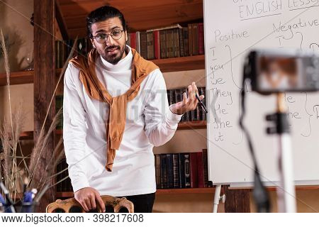 Arab Teacher Man Making Video Lecture For Educational Webinar Teaching English Online Standing Near