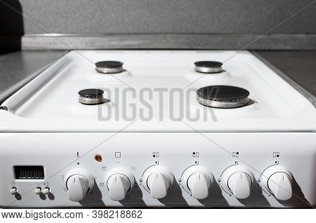 Clean White Surface Of Gas Stove. Gas Panel After Cleaning