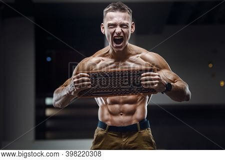 Energy Caucasian Man With A Keyboard Screaming. Information Technology, Programmer And Coder Concept