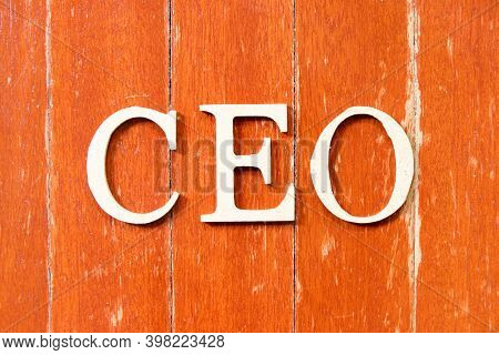 Alphabet Letter In Word Ceo (abbreviation Of Chief Executive Officer) On Old Red Color Wood Plate Ba