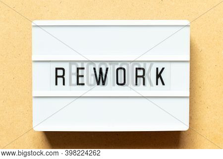 Lightbox With Word Rework On Wood Background