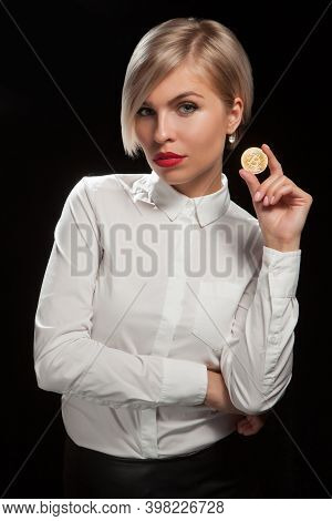 Woman Holding Physical Bitcoin Cryptocurrency Coin In Her Hand