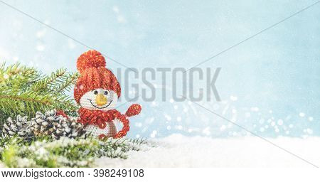 Christmas Or Winter Composition. Little Knitted Snowmans On Soft Snow On Blue Background. Christmas,