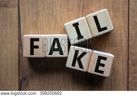 Fail Fake Symbol. Wooden Cubes With Words 'fail Fake' On Beautiful Wooden Background, Copy Space. Bu