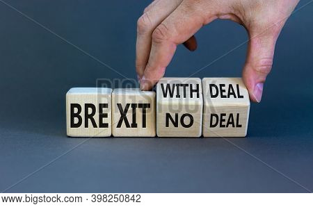 Brexit No Deal Symbol. Hand Turns A Cube And Changes The Words 'brexit No Deal' To 'brexit With Deal