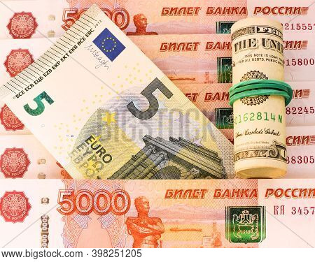 American Dollars, 5 Euro Banknote And 5000 Russian Rubles. Currency Exchange Concept. International