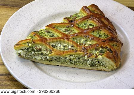 A Slice Of Cottage Cheese And Spinach Pie On A Plate. Delicious Homemade Pie Stuffed With Spinach. H