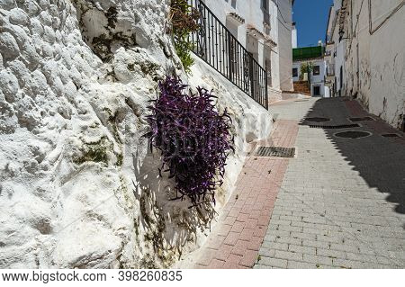 View Of The Cobble Stone Street In The Picturesque Town Of Ojen In Andalusia, Spain