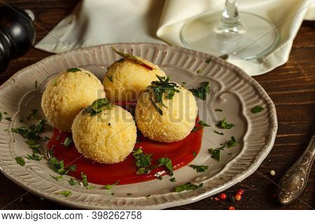 Arancini, Rice Balls With Filling On A Gray Plate With Sauce. Close Up. Popular Street Food, Nationa