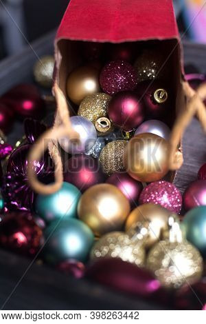 Christmas Balls Roll Out Of Red Paper Gift Bag. Colourful Xmas Decoration And Ecological Package. Ve