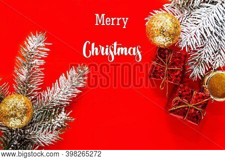 Red Christmas Background, Frame With Fir Branches, Gift Box And Gold Decorations