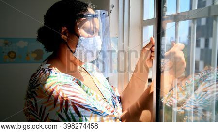 Salvador, Bahia, Brazil - December 6, 2020: Woman Is Seen Wearing Acrylic Face Shield And Protective