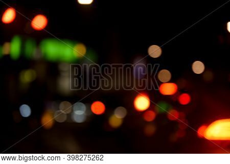 Blurred View Of Urban City Street In Busy Area With Traffic And Shops In Background