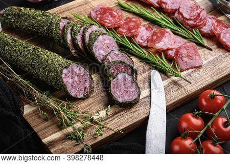 Spanish Fuet Salami Sausage Slices On Balck Background