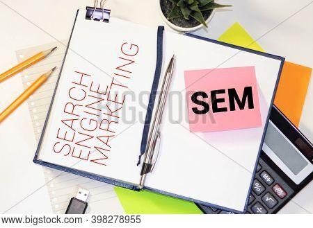 Sem Written In A Notebook. Business Concept