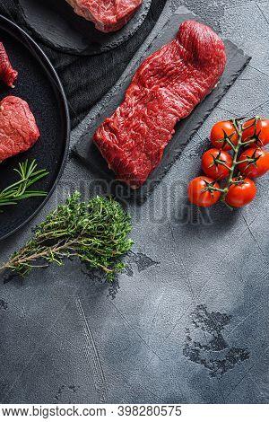Raw Tri Tip, Bottom Sirloin, Or Tri-tip, Triangle Roastcut Black Angus Organic Steak On A Black Plat