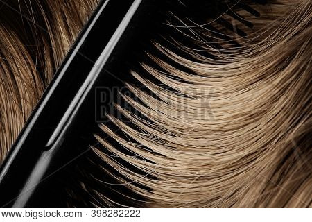 long brown hair as background. human hair detail. long brown hair as background. texture