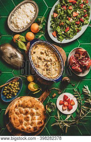 Turkish Style Family Dinner. Flat-lay Green Tile Table With Turkish Lamb In Yogurt Sauce, Rice Pilav