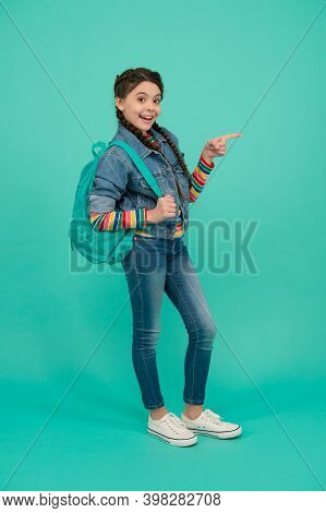 Get What You Eye. Happy Child Pointing Finger Blue Background. Casual Style. Travel Fashion. Trendy