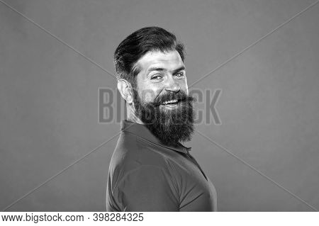 His Long Beard Works Well. Happy Hipster Red Background. Bearded Man With Stylish Hair. Beard Barber