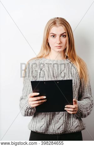 Confident Young Woman Holding Folder With Papers. Local Business, Young Entrepreneur Concept