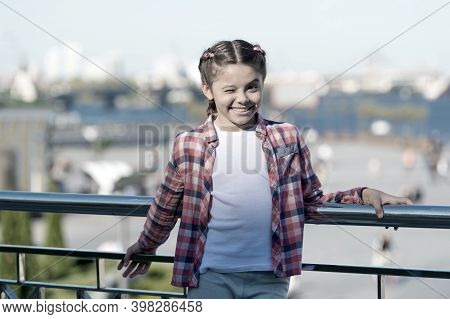 Stylish And Comfortable To Wear. Happy Stylish Child Outdoor. Little Cute Girl With Brunette Hair We