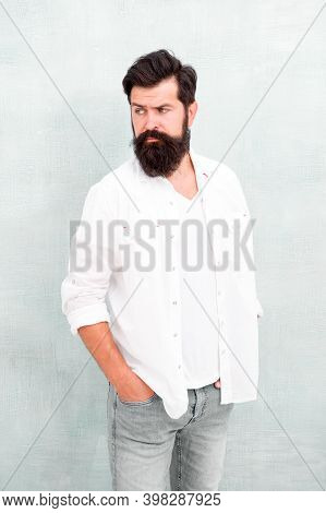 His Style. Male Temper Brutality. Bearded Man Radiate Masculinity. Handsome Hipster Jeans. Male Fash
