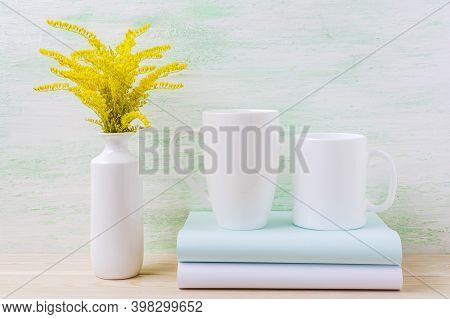 Two White Cappuccino And Coffee Mug Mockup With Yellow Grass.  Empty Mug Mock Up For Design Promotio