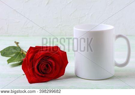 White Coffee Mug Mockup With Sensual Dark Red Rose. Empty Mug Mock Up For Design Presentation.