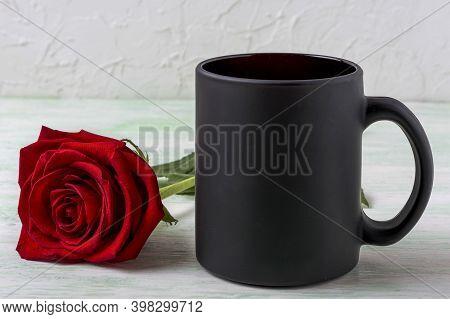 Black Coffee Mug Mockup With Beautiful Red Rose. Empty Mug Mock Up For Brand Promotion.