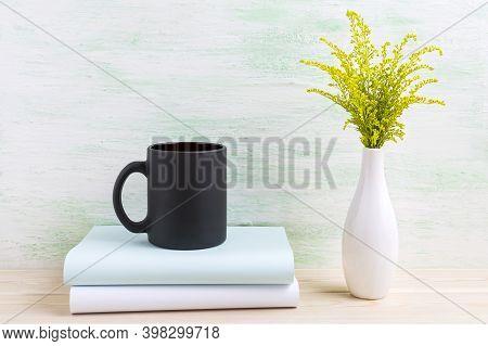 Black Coffee Mug Mockup With Ornamental Green Grass. Empty Mug Mock Up For Brand Promotion.