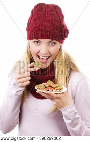 Happy Smiling Woman Wearing Woolen Cap And Shawl And Holding Gingerbreads Or Festive Cookies, Christ