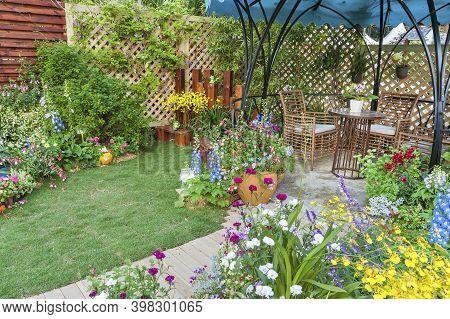 Lush Landscaped Backyard Flower Garden Of Residential House