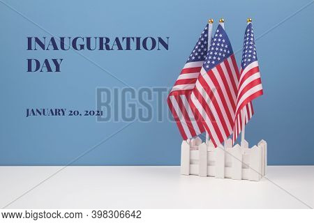 Creative Composition With Usa Flags On White Table With Blue Wall Background, Copyspace For Text. In