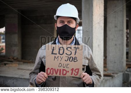 Engineer In Mask And Hardhat Stands With Placard Lost My Job Due Covid-19