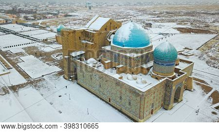 Mausoleum Of Khoja Ahmed Yasawi In Turkestan. Top View From A Drone. Winter Evening, The Sun Goes Be