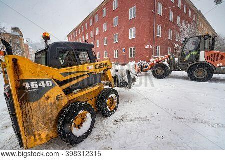 STOCKHOLM, SWEDEN - JAN 03, 2012: Snow shovel machine at work in central Stockholm, Kungsholmen