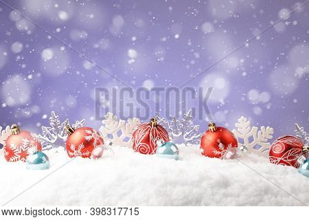 Christmas Red Balls With Snowflakes On Purple Background