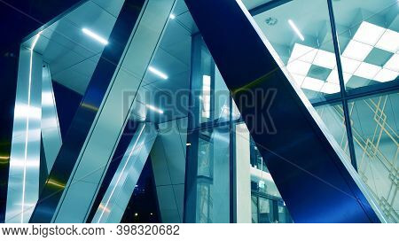Pattern Of Office Buildings Windows Illuminated At Night. Lighting With Glass Architecture Facade De